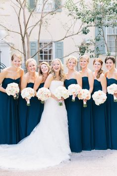 Bride and bridesmaids; navy bridesmaids dresses. Flowers by Tara Guerard Soiree.