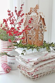 Red and white Christmas vignette with berries, evergreens and gingerbread house -- VIBEKE DESIGN