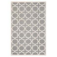 Anchor your living room seating group or define space in the den with this hand-tufted wool rug, featuring an eye-catching geometric trellis motif.