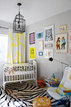 Loving the pops of color, line, and pattern in this nursery!