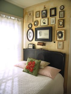 love this cottage bedroom - black headboard and gallery wall are wonderful