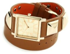 Vince Camuto Women's VC/5028CHBN Leather Square Gold-Tone Brown Double-Wrap Strap Watch Vince Camuto. $150.00. Gold-tone hour, minute and second hand. Water-resistant to 33 M (99 feet). Smooth brown double wrap leather strap with gold-tone pyramid studs and stainless-steel gold-tone buckle closure. 27 x 27 mm square case with gold-tone finish. Champagne dial with gold-tone roman numeral markers at all hours