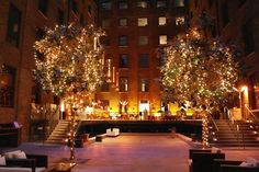 Devonshire Terrace - Warm white pealights in trees, wall uplighters in amber to the building, votives with tealights lining the walkway by www.stressfreehire.com #venuetransformers