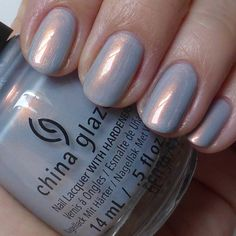 china glaze Rebel collection .It is Pearl Jammin', a light frosty bluey-grey kind of color with a strong copper flash.