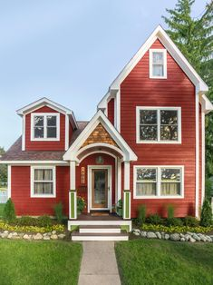This red home in Detroit, Michigan was painted by hand. #curbappeal #hgtvmagazine http://www.hgtv.com/design/outdoor-design/landscaping-and-hardscaping/copy-the-curb-appeal-detroit-michigan-pictures?soc=pinterest