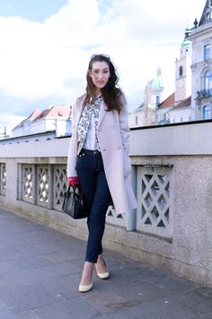 Fashion blogger Veronika Lipar of Brunette From Wall Street sharing how to style black mini bag and white shoes with bomber jacket this spring for a casual day out and about in the city