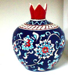 Ceramic pomegranate - hand painted ( by my sister ) in a traditional armenian design & colors. In the Armenian culture the pomegranate symbolizes fertility & abundance. It is also known to be a staple in armenian cuisine.