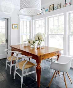 """House tour: Seaside chic style - Style At Home Homeowners Michele and Leon Hatziioannou had the wooden table made for the kitchen's eat-in area about 20 years ago. """"It's part of the family,"""" says Michele. """"It's the table at which our children have eaten since the day they were born."""""""