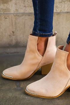 These classic booties will never go out of style. - Vegan suede ankle boots  have a metal tipped toe with a wooden, block heel and side cutouts that  make it ...