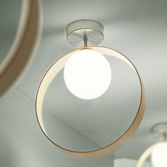 Satin-finish layered and blown glass diffusers. Available with wood rings in ebony finish. http://www.ylighting.com/itr-giuko-wc.html