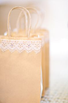 Transform a simple, inexpensive shopping bag into a favor bag with just a bit of lace.