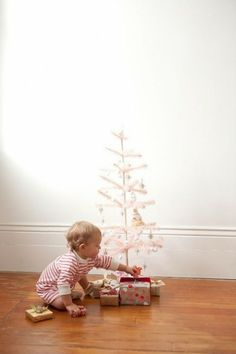 I love the simplicity of this photo. It's a great way to capture your little one in front of their very own tree. Sometimes candid shots are the best!