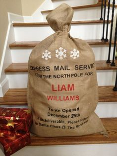 Love love love this idea - Christmas Burlap Santa Bag, Santa Sack, Express Mail Service with Snowflakes, Personalized with Child or Family name on Etsy, $33