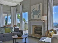Coastal living room. Love the blue crab (plank boards) design & sofa paired w/ white accents.