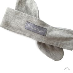@zoeyandlogan Grey Knotted Headband - handmade with a soft fabric that stretches comfortably around your babies head and looks absolutely gorgeous on all baby girls. *0-12 months *The headband top knot is adjustable so that you can tighten and loosen as your child's head grows.