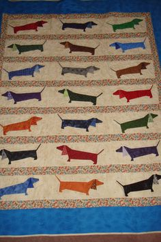 "Paper pieced dachshund quilt made by Pinterest pinner, Mary Shoemaker. The pattern comes from a book, ""It's Raining Cats and Dogs."" She doubled the pattern size."