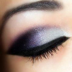 Dramatic purple shadow and liner.