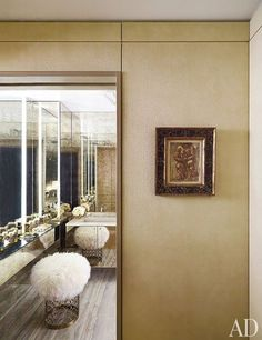 Faux ostrich by Zimmer + Rohde lines the dressing room outside the bath | http://archdigest.com