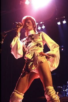 David Bowie, 1973. At a gig at London's Earl's Court wearing a silk printed polo neck. His costumes were inspired by Stanley Kubrick's A Clockwork Orange.