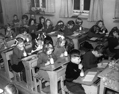 Once a day, school children were sure to get their serving of milk, care of the school board.