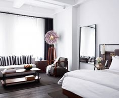 "The pink lamp in the corner of the room, although very subtle, is ""wowing"" the room, thereby creating a bookings magnet.  From the The Most Stylish (and Affordable!) New Hotels in Manhattan via @domainehome"