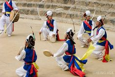 The fast-paced and loud Farmer's Dance--the dancers have to move in formations, play instruments and keep the ribbons on their hats spinning at all times!--Korea