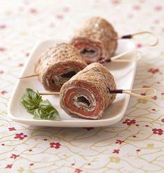 Photo de la recette : Crêpes roulées au saumon fumé et St Môret