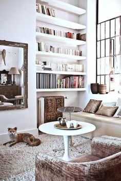 BOOKSHELVES --thebowerbirds:  Source: Milk Mag Hello Mr. Fox, I like yourIkea Docksta table. It ties in well with the quirky mix of Boho/Moroccan meets i...
