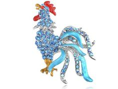 $7.99 Designed in a silver-tone metal, this brooch is a beautifully crafted rooster hen with sapphire blue crystal rhinestones throughout its body. Its tail is a combination of blue crystal rhinestones as well as a gorgeous baby blue enamel paint. This rooster is a fascinating sight and will be perfect for anyone.