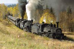 A trio of ex-D&RGW steam locos lead an excursion train on the Cumbres & Toltec scenic railroad.