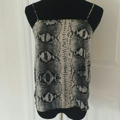 "NWOT Topshop snakeskin crop top Super cute black and white snakeskin pattern silky flowy chiffon like crop top from topshop. Lightweight and perfect for spring and summer. Price flexible, please feel free to make an offer using the ""offer"" button ! I love negotiating price :) Topshop Tops Tank Tops"