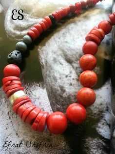 a sensual coral necklace I designed, wild and elegant , made with red bamboo and sponge corals,blue sponge corals, lava stone and sterling silver. a