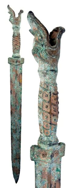 Asian Bronze Sword with an open mouthed dragon head on the handle, with traces of gold gilding. 400-200 BC