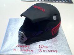 Birthday cake in the shape of a Honda dirt bike helmet