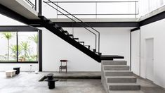Chunky black steelwork frame the sparsely furnished spaces inside this house in Ribeirão Preto, Brazil designed by architecture firm Estúdio BG. Stair Shelves, Staircase Storage, Staircase Handrail, Interior Staircase, Bauhaus, White Brazilian, Metal Stairs, Minimalist Home, Architecture