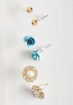 Each day brings a new mood, and this trio of studs has every attitude covered. For more subdued days, you'll enjoy the round gold beads bedecking your lobes. Sassier occasions call for the turquoise roses this set offers, and the rhinestone-framed, faux-pearl pair primes you for the fanciest of days!