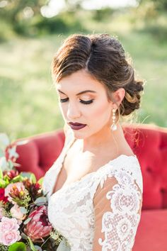 Romantic bridal style, dramatic wedding makeup, bold lashes, burgundy lipstick, up-do wedding hairstyle, follow this board for more wedding makeup inspiration // Allison Jeffers Wedding Photography