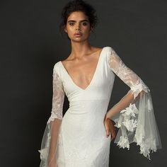So much beauty in one dress! Our stunning Francis dress unfolds like a fairytale as it walks down the aisle - it's magic Francis is also available without the gorgeous tulle bell sleeves, and elegantly finishes at the elbow with appliquéd hand-cut lace motifs. This dress is truly a show stopper. Xx