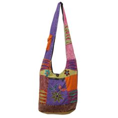 Fancy trendy bag made from 100% cotton. Colourful patch work adorned by simple appliqué work of floral motif on top and the razor cut details on shoulder strap and front is a perfect accessory to complete your bohemian look.