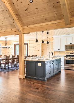 In contrast to the rich, cinnamon shade of stain selected for the home's exterior, the interior white pine logs are clear coated, showcasing the wood's knots and grain and keeping the rooms bright.