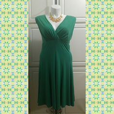 Green Dress Green Dress by Voir Voir. The dress is 95% polyester and 5% spandex. Very nice for a night on the town or date night. ?? Voir Voir Dresses