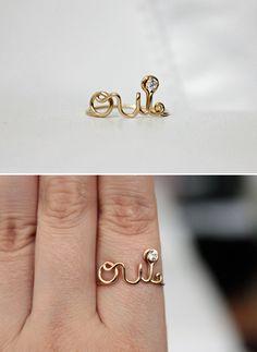oui ring 14k gold filled, $45. (http://www.etsy.com/listing/71804202/oui-ring-14k-gold-filled)