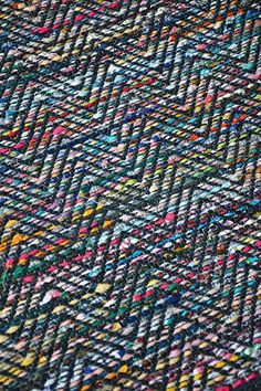This is what I imagine weaving with Noro on black would look like and I LOVE IT. Inkle Weaving, Card Weaving, Weaving Art, Weaving Textiles, Weaving Patterns, Rug Inspiration, Weaving Projects, Weaving Techniques, Woven Rug