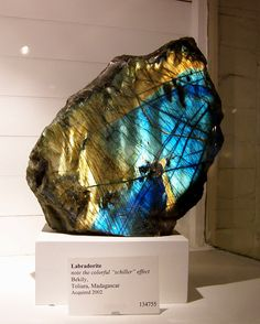 Labradorite, a feldspar mineral, is an intermediate to calcic member of the plagioclase series. http://en.wikipedia.org/wiki/Labradorite