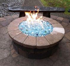 Stone Glass Firepit Fireplace Glass Rocks, Fire Pit Glass Rocks, Stone Fireplace Designs, Gas Fireplace Logs, Rock Fireplaces, Fire Glass, Cool Fire Pits, Fire Pit Designs, Glass Installation