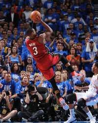 Dwyane Wade of the Miami Heat shoots against Daequan Cook of the Oklahoma City Thunder during Game One of the 2012 NBA Finals, #NBAFinals #MiamiHeat http://www.fansedge.com/Dwyane-Wade-Miami-Heat-NBA-Finals-Game-1-6122012-_-14157084_PD.html?social=pinterest_pfid77-20076
