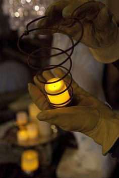 Old bed springs are repurposed votive holders with ribbon to hang them.. be sure to use battery operated votives. {junk gypsy co}