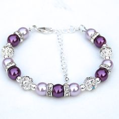 Purple and lavender pearls mixed with glittering rhinestones have been used in this summer or bridesmaid bracelet. I have strung 8mm glass pearls with rhinestones. Sterling silver beads have also been used as spacers. The bracelet measures 7.5/19cm and is finished with a sterling silver
