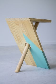 I designed and started making these side tables in 2013 and since have taken a handful of orders from friends. Despite the visual illusion of the dowel, this piece of furniture is very stable. The sid...
