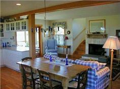 This oceanfront Nantucket vacation rental living room has a wood burning fireplace. Crashing waves outside  and a crackling fire inside.